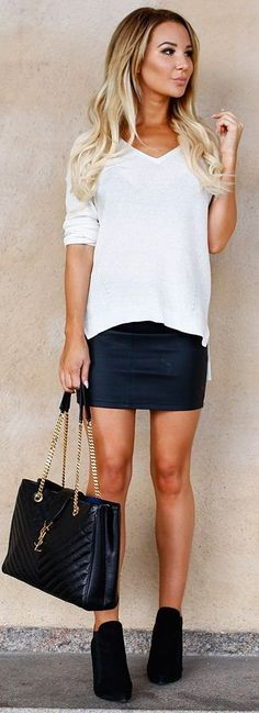 YSL bag with plain white top and Leather Skirt. Looks great with her suede booties. Effortless and minimal outfit.