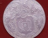 armorial (unidentified) mother of pearl gaming counter, China,for  European market-  18th century