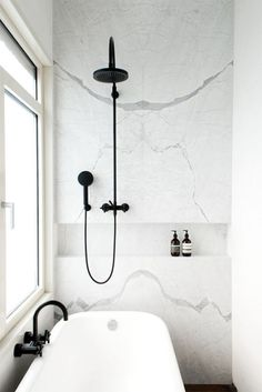 white marble and black fixtures
