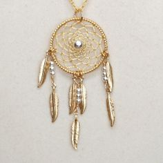 Dream Catcher Silver & Gold Dreamcatcher Necklace with Feathers. $25.00, via Etsy.