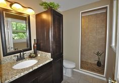 Traditional 3/4 Bathroom with Flat panel cabinets, Ms international blanco tulum granite, specialty door, Flush