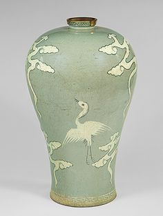 Metropolitan Museum of Art Maebyeong, Goryeo dynasty (918–1392), late 13th–early 14th century Korea Stoneware with inlaid decoration of cranes and clouds under celadon glaze  H. 11 1/2 in. (29.2 cm) Fletcher Fund, 1927 (27.119.11)