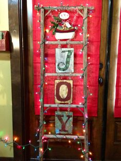 Old ladder decorated for Christmas or fall, You could change this out for any season or holiday