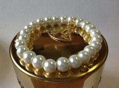 Glass pearls with gold etno pendant