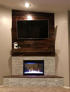 Some great electric fireplace ideas with a TV above for your viewing pleasure. Making your dual-purpose entertainment center is easy with a beautiful electric fireplace stove. #electricfireplace #fireplace #fireplaceideas #homeideas Corner Fireplace Mantels, Corner Electric Fireplace, Corner Gas Fireplace, Basement Fireplace, Fireplace Doors, Farmhouse Fireplace, Fireplace Hearth, Fireplace Remodel, Fireplace Inserts