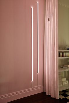 blush walls with minimal vertical lighting
