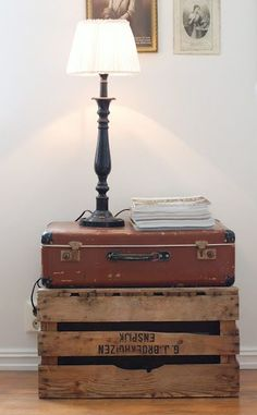 Fabulous homemade nightstand using an old crate, vintage suitcase... love this.