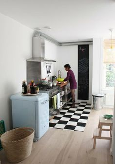 Checkered kitchen floor with baby blue mini smeg