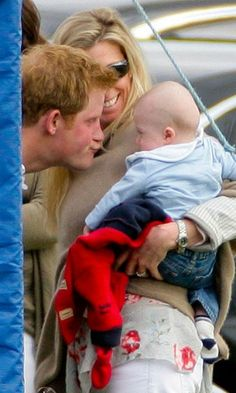 A baby appeared amused by Prince Harry's silly face at a 2012 Audi Polo Challenge charity polo in Ascot, England