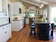 See this farmhouse kitchen with island bar seating and traditional glass-front cabinets on HGTV.com.