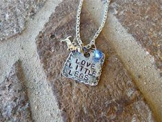 SQUEE!  Love Little Legs doxie necklace.  Artist is donating one to our April 20 event in ATL!