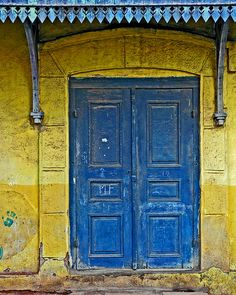 Blue door with yellow wall: contrast