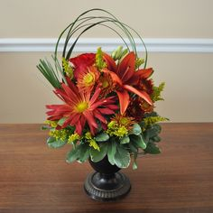 Petit seasonal arrangement for a console table