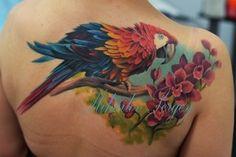 tattoo parrot on a flower bush