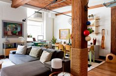 eclectic living room by Rikki Snyder  - rope wrapped column