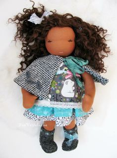 Tütti is a 12'' tall FeeVerterlaine doll.  She comes with her complete outfit {dress, wool crochet boots, panties and cape}. She has gorgeous terra cotta skin, brown eyes, and curly brown weft hair.