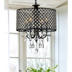 Create a dramatic accent in your home with this striking four-light chandelier. The antique black shade features a bold diamond pattern and encases dozens of dazzling crystals, which gently catch the