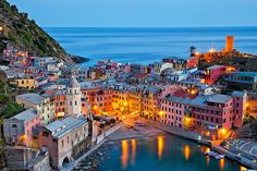 """Cinque Terre, Italy.  """"Dusk Colour"""".  Village of Vernazza.  I would love to poof away to this little seaside village!"""