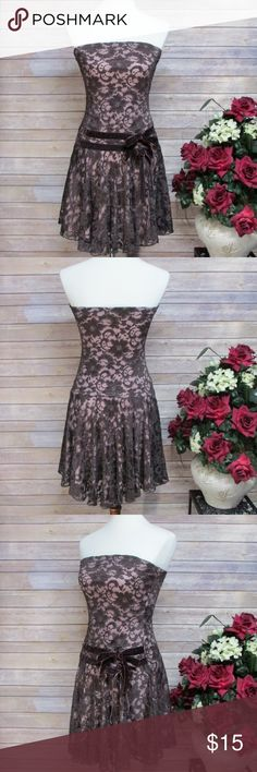 """Honey Punch Brown Lace Overlay Strapless Dress DETAILS • Floral lace over contrast lining skater dress. • Strapless straight neckline. • Front double velvet ribbon ties. • High-low hemline. • No closures. • Brown/Pink. • 89% Nylon, 11% Spandex. • Lining 100% Polyester.  CONDITION Excellent condition.  SIZE 