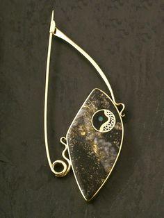 "Donald A. Stuart: ""Galaxie"" Fibula  18K gold, inlays of gold ore (Ontario), ebony, opal, 14K gold. 8 x 3.5 cm"