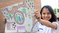 A student at Larry G. Smith Elementary School in Mesquite, Texas, shows off her design for a school garden. Click through our gallery to see more of the garden.