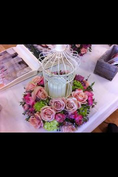 Birdcage centerpiece but with blue and green hydrangeas and white or pink roses