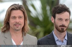 Brad Pitt and Scoot McNairy pose at the KILLING THEM SOFTLY photocall during the 65th Annual Cannes Film Festival at Palais des Festivals on May 22, 2012 in Cannes, France.
