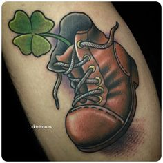 Lucky old shoe tattoo. By Dmitry Rechnoy. XKTattoo