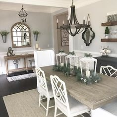 Not sure why the Chinese chairs with this, but I love the mirror, chandelier, and other touches--also the pretty beige woods and white and dark gray. Nice!