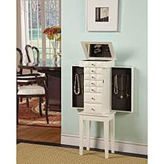 @Overstock - Tapered legs and a versatile white finish highlight this Diamante 6-drawer jewelry armoire. A flip-top compartment with inset mirror completes this elegant armoire.http://www.overstock.com/Home-Garden/Diamante-White-6-Drawer-Jewelry-Armoire/5548832/product.html?CID=214117 ILS              744.60