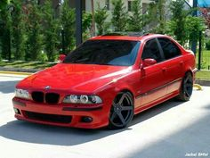 BMW E39 5 series red with black rims