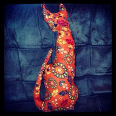 This is a cat named Debbie Downer, I sewed her by hand. She lives at the Halflounge in Burlington, VT.