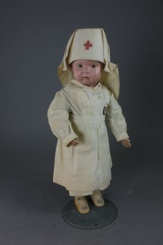 Schoenhut dressed as Red Cross nurse for WWI. Vintage Nurse, Vintage Dolls, Vintage Medical, Girl Dolls, Baby Dolls, Dolly Doll, Valley Of The Dolls, Old Dolls, Bear Toy