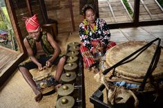 The k'lintang and t'nonggong are played to accompany dance.  The t'nonggong  belongs to the megel/lembang category of T'boli music instruments which has male attributes such as being loud and hard-sounding and played in the public sphere.  Drummers are usually male.  Providing a rhythmic ostinato to the t'nonggong is the k'sal, a pair of wooden sticks which are struck on a bamboo floor. Photo:  Marlon A. Martinez Percussion Drums, Bamboo Floor, Lembang, Mindanao, Drummers, Musical Instruments, Philippines, Sticks, Musicals