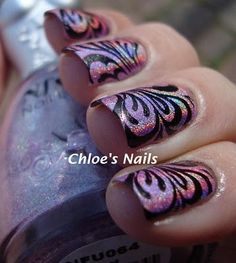 Konad M63 - this is my favourite stamping plate / pattern!  Chloesnails have done a great combi with the holo and the black! Must try this one!