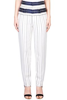 Wear now:Pair with a slick navy turtle neck and slide into a pair of mules while the weather is chilly. Wear later:Swap that chunky jumper for a slinky white halter top and take these pants straight out from the office. Pants, $664, Chloéat Tuchuzy