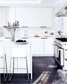 ikea kitchen cabinets. gorgeous floor and that stunning herringbone marble back splash