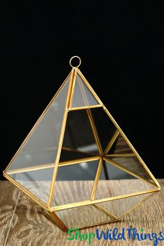Trying to come up with unique centerpieces and new ideas for decorations can be challenging.This Geometric Hanging Terrarium with Gold Trim offers a novel twist to home and event décor and is a trendy