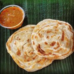 The good old roti prata or indian pancake with fish or meat curry gravy. Prata may come fillings, eggs being the most common, and you can also have a combo of egg and onion. There are also cheese, banana and chocolate pratas. And prata topped with ice-cream! Just like crepes. Eating prata is sometimes not complete without drinking the sweet teh tarik or condensed milk 'pulled' drink. In Malaysia roti prata is commonly known as roti canai.