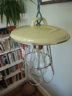 From reader Eric Smillie comes this great tutorial for making a hanging pendant light, inspired by old enamel barn and factory lamps. The real deal can be rather pricey, but Eric came up with a clever way to get the look for a lot less. Using old cookware found at secondhand stores, he fashions new lamps using enameled pot lids as the shades. The final lamp will depend on the pot lid you buy, and can look either industrial, rustic, or cottage.