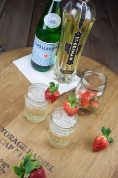 The St. Germaine Cocktail:  Champagne - 2 ounces St. Germain - 1 1/2 ounce San Pellegrino - 2 ounces Strawberries - for garnish
