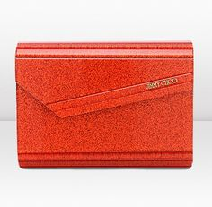 Jimmy Choo - -Candy $650.00 LOL comes in this (tangerine) and citrine (aka yellow) I love this too... not so much the yellow... God forbid I win pch, cause I'm gonna buy some stuff! :)