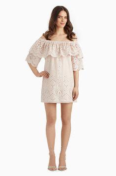 A blush off-the-shoulder dress with eyelet details.