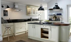 Wren Kitchens: Shaker Alabaster Timber - Create a tranquil space with this elegant design, and experience top-end quality for a kitchen you can enjoy for years to come. Black granite is striking and beautifully contrasts the traditional shaker door style.