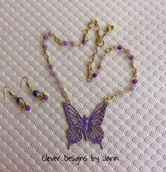 July Challenge ..Fairy Necklace with matching earrings .. I used Iced Enamel on the fairy stamping .. everything is from B'sue except for the chain, small beads and bead caps .. Clever Designs by Jann .. https://www.etsy.com/shop/CleverDesignsbyJann