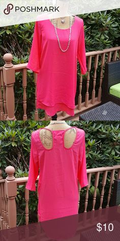 Pink Tunic Bright pink tunic. There is a small fray on the back by the neckline as shown in photo 3 that can probably be sewn. 100% polyester. True Light Tops Tunics