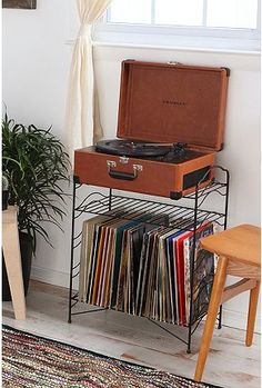 Record storage shelf.. Haha I just bought one of these for $2, going to spray it and use it for magazines!
