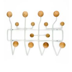 Made from a framework of coated steel wire with lacquered natural wood balls, this modern take on a classic hat rack gives you enough knobs and nodules for all your accessories. Appealing to the eye with its use of angles and shapes, the maple knobs add the perfect piece of natural texture.