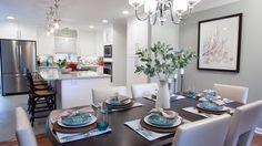 Bright white kitchen featuring Hood classic globe pendants from Rejuvenation