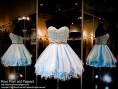 This super cute short homecoming dress features a lace sweetheart bodice with a waistband beaded with iridescent AB stones.  The skirt has multiple layers of tulle for a full effect. Available in baby blue and it's at Rsvp Prom and Pageant, Atlanta, Georgia!